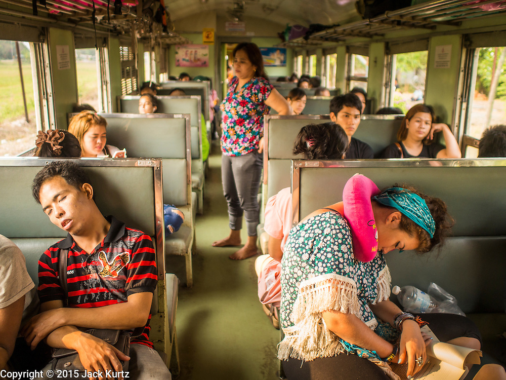 20 MARCH 2015 - CHACHOENGSAO, CHACHOENGSAO, THAILAND:  People sleep on a 3rd class train heading for Kabin Buri. The State Railways of Thailand (SRT), established in 1890, operates 4,043 kilometers of meter gauge track that reaches most parts of Thailand. Much of the track and many of the trains are poorly maintained and trains frequently run late. Accidents and mishaps are also commonplace. Successive governments, including the current military government, have promised to upgrade rail services. The military government has signed contracts with China to upgrade rail lines and bring high speed rail to Thailand. Japan has also expressed an interest in working on the Thai train system. Third class train travel is very inexpensive. Many lines are free for Thai citizens and even lines that aren't free are only a few Baht. Many third class tickets are under the equivalent of a dollar. Third class cars are not air-conditioned.    PHOTO BY JACK KURTZ