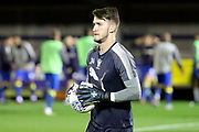 AFC Wimbledon goalkeeper Joe McDonnell (24) with ball in hands during the EFL Trophy match between AFC Wimbledon and Tottenham Hotspur at the Cherry Red Records Stadium, Kingston, England on 3 October 2017. Photo by Matthew Redman.