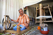 A man sitting on the floor spinning cotton, Turkey