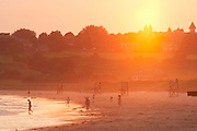 Middletown, RI 2006 - people enjoy second beach during the warm glow of a summer sunset.