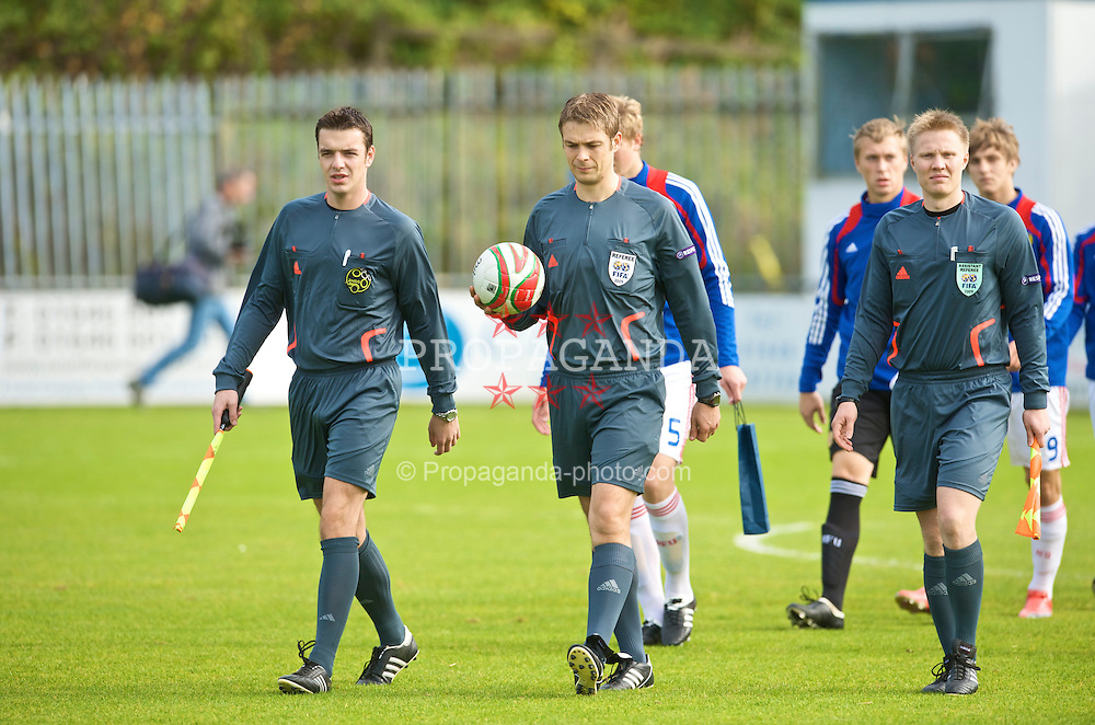 HAVERFORDWEST, WALES - Saturday, October 3, 2009: Referee Mattias Gestranius and his assistants Jan-Peter Aravirta and Mariano Debono walk out before the UEFA Under-17 Championship Qualifying Round Group 12 match between Wales and Russia at Bridge Meadow Stadium (Pic by David Rawcliffe/Propaganda)