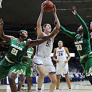 STORRS, CONNECTICUT- NOVEMBER 17: Natalie Butler #51 of the UConn Huskies rebounds while challenged by Kalani Brown #21 of the Baylor Bears and Alexis Jones #30 of the Baylor Bears during the UConn Huskies Vs Baylor Bears NCAA Women's Basketball game at Gampel Pavilion, on November 17th, 2016 in Storrs, Connecticut. (Photo by Tim Clayton/Corbis via Getty Images)