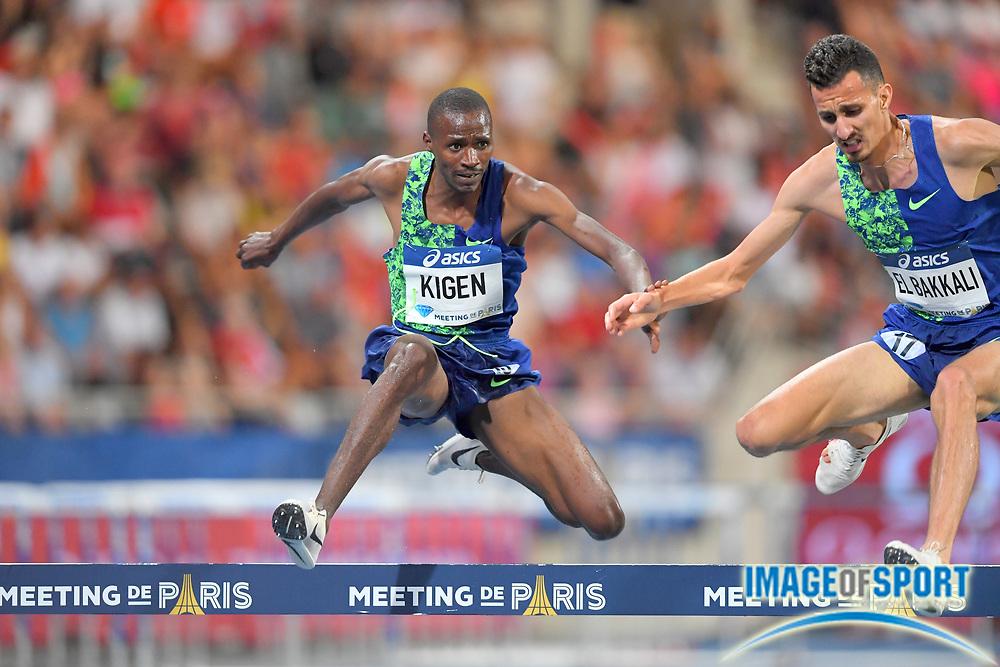 Soufiane El Bakkali (MAR), right, defeats  Benjamin Kigen (KEN) to win the steeplechase, ,8:06.64 to 8:07.09, during the Meeting de Paris, Saturday, Aug. 24, 2019, in Paris. (Jiro Mochizuki/Image of Sport via AP)