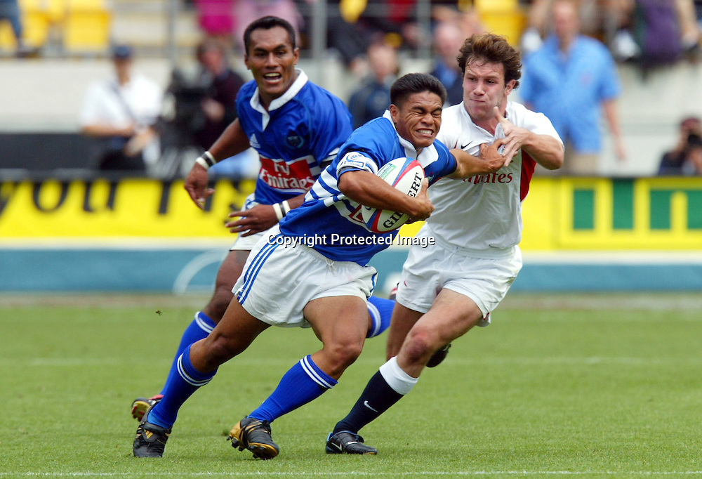 07 February 2004, Westpac Stadium, Wellington, IRB New Zealand Sevens.<br />England vs Samoa<br />Samoa's Fili Fa'atonu gets tackled by England's James Brooks during England's 19-7  Quater Cup win over Samoa on Saturday at the Sevens in Wellington.<br />Please Credit: Marty Melville/Photosport