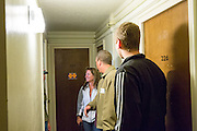 Tom and Melanie Birchler with their tour guide Michael Galloway talk to a resident of Cady Hall about how the way dorms used to be. On Oct. 10, 2014.