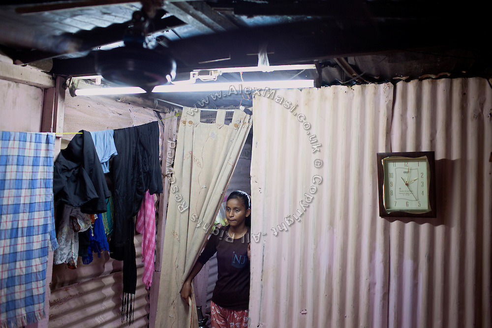 Mayuri Mahesh Pandit, 13, is walking around her modest home, before leaving to participate at the Unicef-run 'Deepshikha Prerika' project inside the Milind Nagar Pipeline Area, an urban slum on the outskirts of Mumbai, Maharashtra, India, where she resides with her family.
