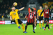 Wolverhampton Wanderers defender Matt Doherty (2) and Andrew Surman (6) of AFC Bournemouth during the Premier League match between Wolverhampton Wanderers and Bournemouth at Molineux, Wolverhampton, England on 15 December 2018.
