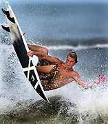 Jonny Legut of Ormond Beach, Fla. catches some air and a good afternoon for waves during the rising tide on Ormond Beach, Fla. on Monday, May 3, 2004. (Craig Litten, Daytona Beach News-Journal)<br /> *** STAND ALONE FEECH ***