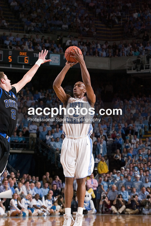 07 February 2006: Junior forward Reyshawn Terry (3) is defended by freshmen forward Josh McRoberts (2) during a Duke Blue Devils 87-83 victory over the North Carolina Tarheels, in the Dean Smith Center in Chapel Hill, NC.