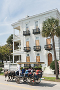 A horse carriage tour passes a boarded up home in preparation for Hurricane Irma on the historic Battery September 8, 2017 in Charleston, South Carolina. Imra is expected to spare the Charleston area but hurricane preparations continue as Irma leaves a path of destruction across the Caribbean.