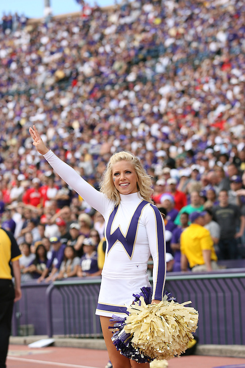 SEPT 11 2010: Cheerleaders cheer for the Washington Huskies. The Washington Huskies are defeated by the Nebraska Cornhuskers 56-21 at Husky Stadium in Seattle, WA. Photo by Tom Hauck.