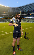 Twickenham. UK.   Oxford's, Captain and man of the match, poses with the trophy, after Oxford win the 2013 Varsity Rugby Match, defeating Cambridge 33 - 15 on    Thursday  12/12/2013, at the RFU Stadium.  Surrey, England  [Mandatory Credit. Peter Spurrier/Intersport Images]