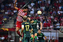 September 20, 2018 - Piraeus, Attiki, Greece - Ahmed Hassan (no 18) of Olympiacos attempt to score under the pressure of Real Betis defence. (Credit Image: © Dimitrios Karvountzis/Pacific Press via ZUMA Wire)