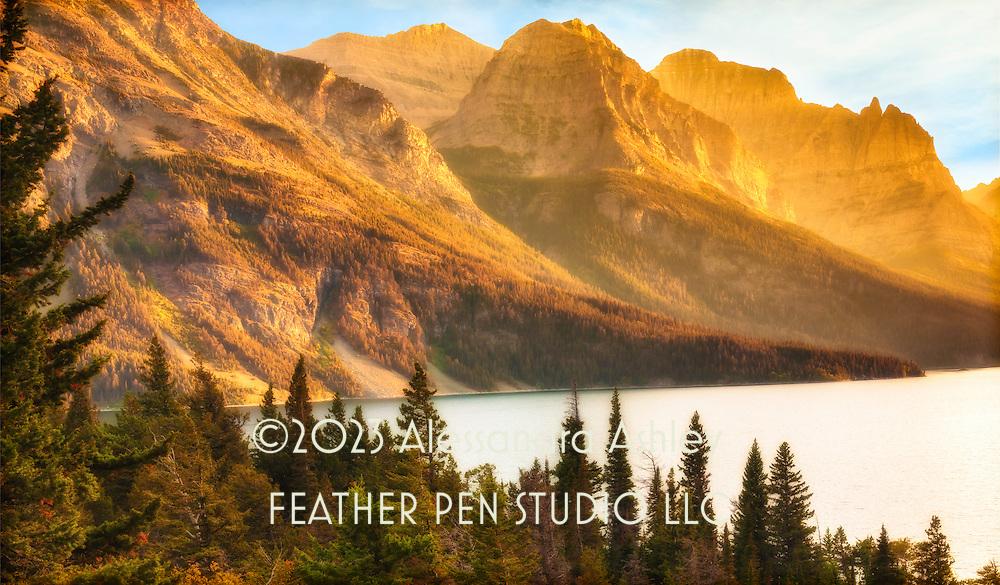 Golden evening light over St. Mary Lake, Glacier National Park, northwest Montana.