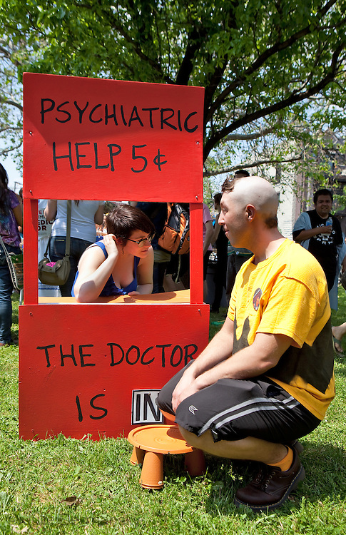 May 19, 2012, Chicago, A demonstrator dressed as Charlie Brown in an Occupy group called Save Our Clinics, holds a prop out of a Peanuts cartoon offering Psychiatric hlep for five cents while marching to Chicago Mayor Rahm Emanuel house protest . Chicago recently closed half of its' clinics and privatized the rest. Occupy Wall Street in a and Occupy movement groups from around the country join Occupy Chicago to protest NATO and the G8.