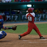 15 February 2009: Alexei Bell of the Orientales hits the ball during a training game of Cuba Baseball Team for the World Baseball Classic 2009. The national team is pitted against itself, divided in two teams called the Occidentales and the Orientales. The Orientales win 12-8, at the Latinoamericano stadium, in la Habana, Cuba.