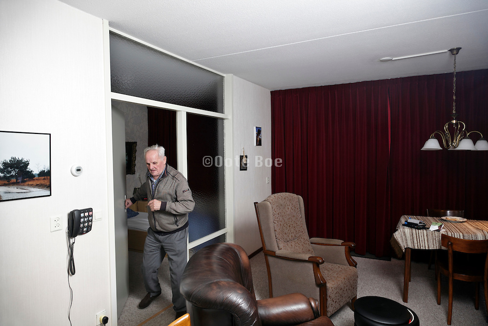 senior man coming out the bedroom