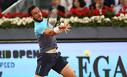 May 8, 2018 - Madrid, Spain - Damir Džumhur of Bosnia returns the ball to Juan Martin Del Potro of Argentina in the 2nd Round match during day four of the Mutua Madrid Open tennis tournament at the Caja Magica. (Credit Image: © Manu Reino/SOPA Images via ZUMA Wire)