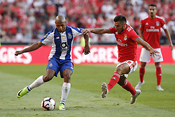 October 7, 2018 - Lisbon, Portugal - Yacine Brahimi of Porto (L) vies for the ball with Eduardo Salvio of Benfica (R)  during the Portuguese League football match between SL Benfica and FC Porto at Luz Stadium in Lisbon on October 7, 2018. (Credit Image: © Carlos Palma/NurPhoto/ZUMA Press)