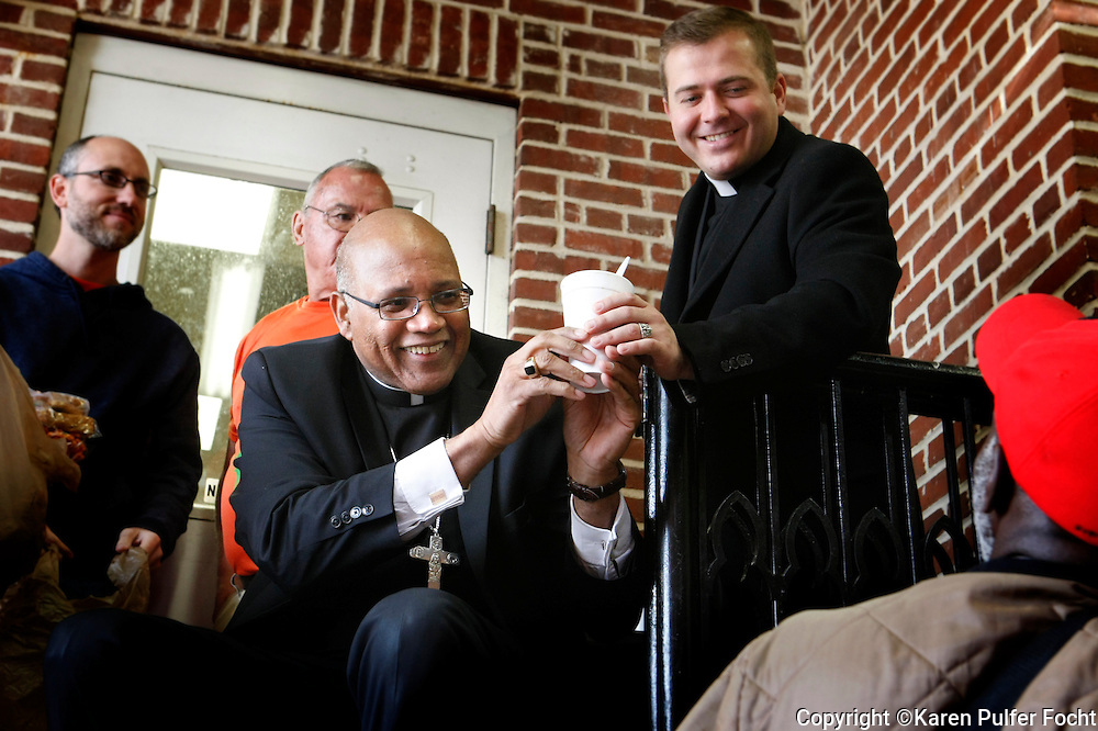BISHOP MARTIN HOLLEY, the new Catholic Bishop of Memphis, Tennessee passes out hot soup and sandwiches to the hungry at St. Mary's Soup Kitchen, Memphis, Tennessee. Poverty, hunger and homelessness continue to plague Memphis, one of the poorest big cities in America. Bishop Martin D. Holley, newly installed Bishop for the Catholic Diocese of Memphis joined in the effort as one of his first 100 Days of Service outreaches. Bishop Holley greeted guests receiving new clothing, served them breakfast from St. Mary's Soup Kitchen, the longest continuously running soup kitchen in the United States.