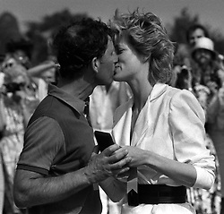 A kiss for the Prince of Wales from Princess Diana, when she presented him with a runners up medal after his team, Windsor Park, were beaten in the final of the Garrard Trophy, at Smith's Lawn, Windsor.