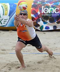 16-08-2014 NED: NK Beachvolleybal 2014, Scheveningen<br /> Tim Oude Elferink (2)