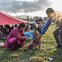 a family in a makeshift camp in kathmandu<br /> <br /> A local field in the city centre is used by locals for safe overnight sleeping after they lost their homes in Kathmandu, Nepal 27th April 2015 following the devastating earthquake that hit the country on 25 April 2015