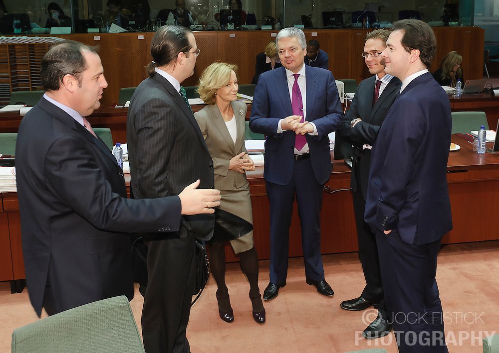 From left,  Josef Proell, Austria's finance minister, arrives as Anders Borg, Sweden's finance minister, Elena Salgado, Spain's finance minister, Didier Reynders, Belgium's finance minister, Jyrki Katainen, Finland's finance minister, and George Osborne, the UK's chancellor of the exchequer, have a conversation during a meeting of EU finance ministers, at the European Council headquarters, in Brussels, Tuesday, Dec. 7, 2010. (Photo © Jock Fistick).