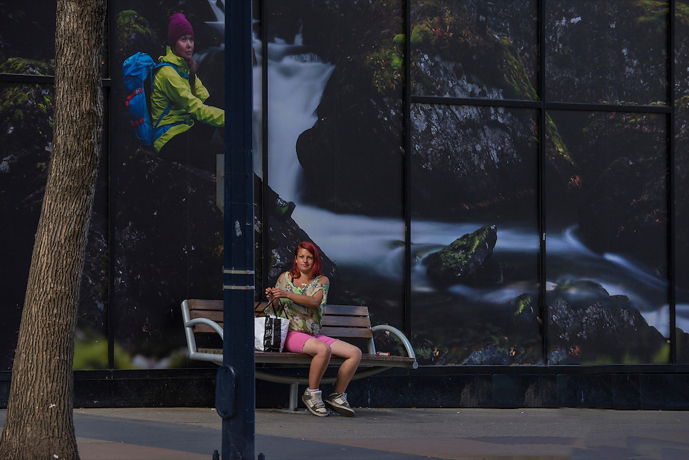 Canada, Alberta, Edmonton, woman on bench in downtown