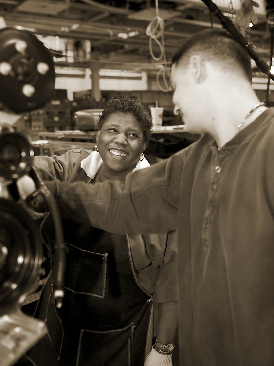 General Motors workers assemble a Malibu car engine at the factory in Fairfax, KS.