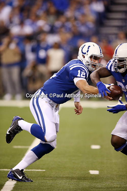 Indianapolis Colts quarterback Andrew Luck (12) hands off the ball on a running play during the 2015 NFL week 2 regular season football game against the New York Jets on Monday, Sept. 21, 2015 in Indianapolis. The Jets won the game 20-7. (©Paul Anthony Spinelli)