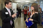 student Cheryl Miller (left) talks with Steve Eich at the Career Fair on Wednesday, 10/11/06.