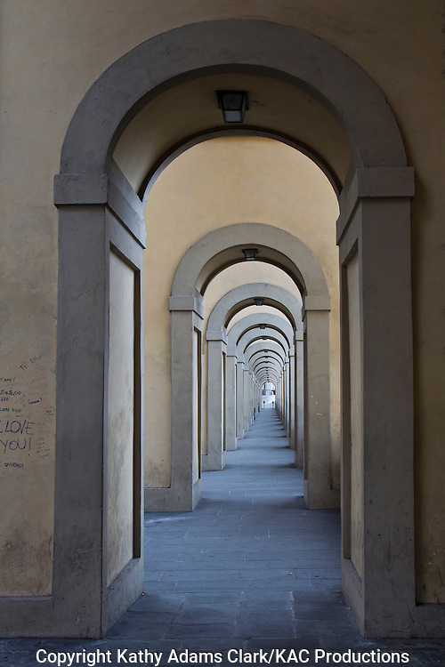 arcade next to the Ponte Vecchio, Florence, Firenze, Italy.