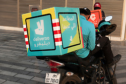 Deliveroo drivers on mopeds in Dubai, UAE