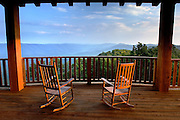 wooden rocking chairs positioned perfectly on the porch to take in the beautiful mountain range in West Virginia.