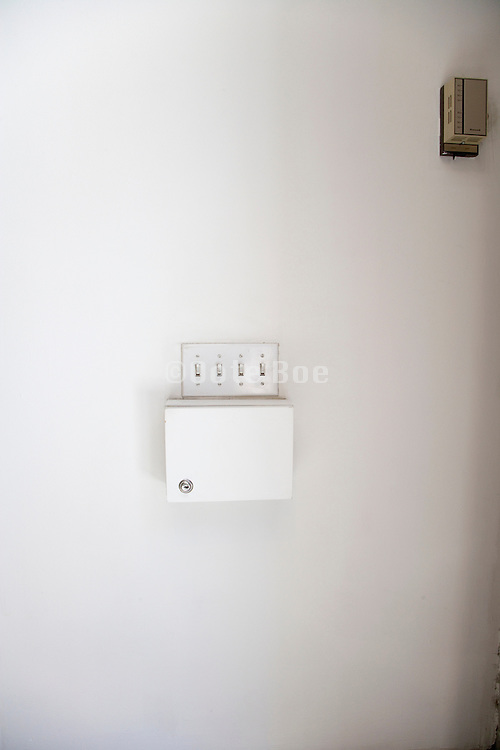light switches and thermostat on a wall