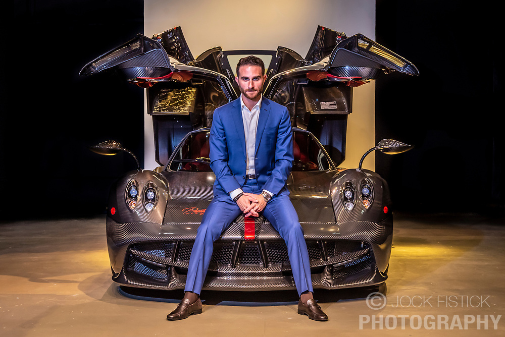 Brett David, CEO of Prestige Imports, with his Pagani Huayra, valued at $3 million.