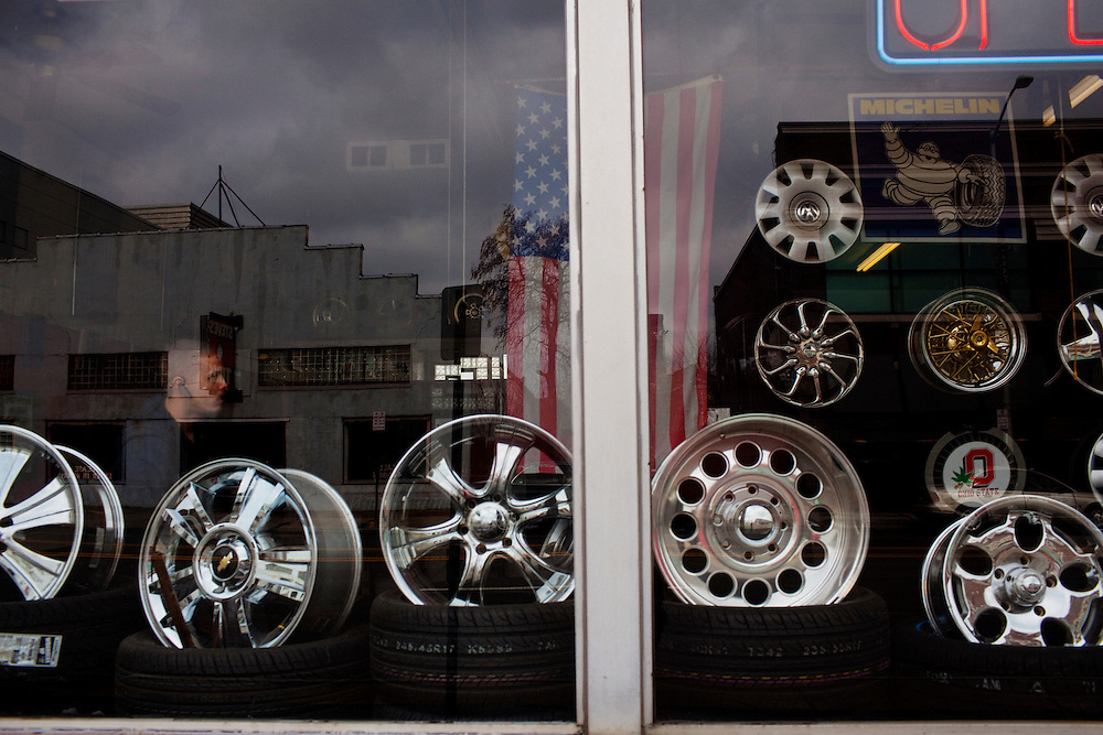 Rims on display in the window of Katz Tires in Columbus, Ohio on Friday, February 25, 2011. Senate Bill 5 would eliminate collective bargaining rights for state workers, which Governor John Kasich claims is a necessary reaction to the budget crisis.