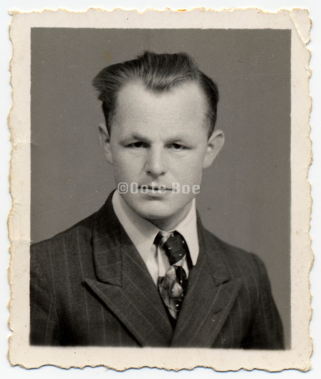 vintage identity photograph of an intense looking young man