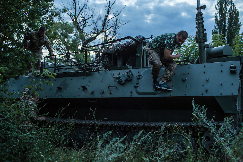 AVDIIVKA, UKRAINE - JULY 9, 2016: Ukrainian soldiers dismount from an MT-LBu personnel carrier in Avdiivka, Ukraine. The town is now one of the most active areas of fighting along the line of control between the Ukrainian government and Russian-backed rebels. CREDIT: Brendan Hoffman for The New York Times