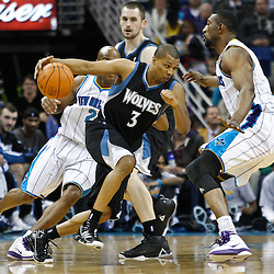 February 7, 2011; New Orleans, LA, USA; Minnesota Timberwolves point guard Sebastian Telfair (3) drives into New Orleans Hornets center D.J. Mbenga (28) during the second quarter at the New Orleans Arena.   Mandatory Credit: Derick E. Hingle