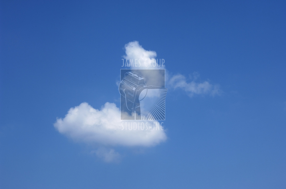 two small clouds against a blue sky