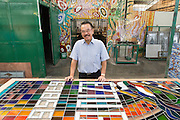 Eztu Glass founder and CEO Brian Yaputra poses for a portrait at his company's factory in Tangerang, near Jakarta, Indonesia, on July 2, 2015.
