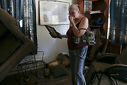 August 30, 2017 - La Grange, Texas, U.S. - BRENDA SMITH, 60, gets emotional after returning to her house Wednesday. Smith's house and many others in an area were flooded by the Colorado River with rains from Hurricane Harvey. (Credit Image: © Jerry Lara/San Antonio Express-News via ZUMA Wire)