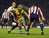 PICTURE BY DANIEL HAMBURY/SPORTSBEAT IMAGES<br /> Nationwide Football League Division One    2/3/04<br /> <br /> Norwich City V West Bromwich Albion<br /> <br /> Norwich City's Darren Huckerby squeezes between West Brom's James Chambers and Bernt Hass