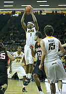 December 04 2010: Iowa Hawkeyes forward Melsahn Basabe (1) pulls down a rebound during the first half of their NCAA basketball game at Carver-Hawkeye Arena in Iowa City, Iowa on December 4, 2010. Iowa won 70-53.