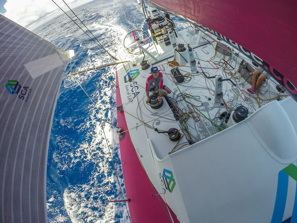 October 22, 2014. Leg 1 onboard Team SCA. Stacey Jackson trims during the doldrums.