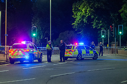 © Licensed to London News Pictures. 20/06/2020. Reading, UK. Police vehicles at a cordon close to Forbury Gardens. Police on site at Forbury Gardens Gardens in Reading responding to reports of a stabbing. Police and paramedics responded on mass to the incident including at least two air ambulances. Photo credit: Peter Manning/LNP