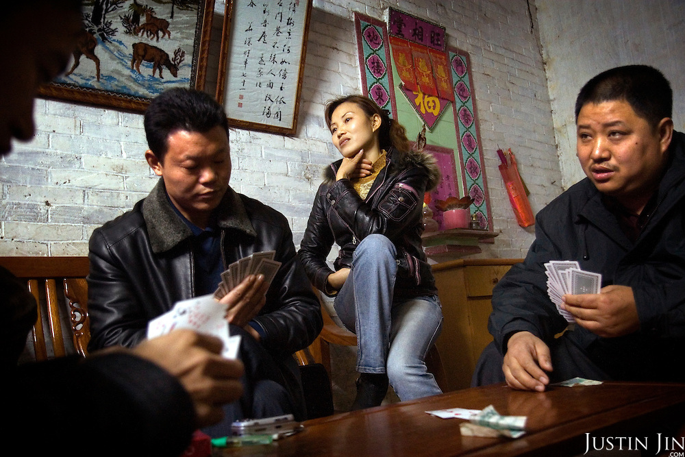 "Factory boss Mr Huang (top left corner) plays cards with fellow bosses and their wives at his home in Zhongshan city, China..This picture is part of a photo and text story on blue jeans production in China by Justin Jin. .China, the ""factory of the world"", is now also the major producer for blue jeans. To meet production demand, thousands of workers sweat through the night scrubbing, spraying and tearing trousers to create their rugged look. .At dawn, workers bundle the garment off to another factory for packaging and shipping around the world..The workers are among the 200 million migrant labourers criss-crossing China.looking for a better life, at the same time building their country into a.mighty industrial power."