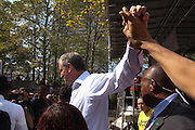 Brooklyn, NY Oct. 5, 2013. Mayoral Candidate Bill de Blasio high fives a supporter at an immigration rally in Cadman Plaza. 10052013. Photo by Kayle Hope Schnell/NYCity Photo Wire.